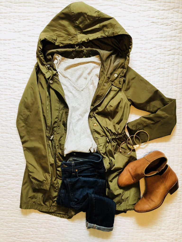 flatlay photo with anorak jacket, jeans and booties