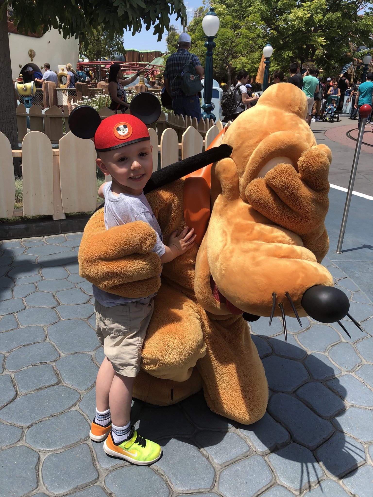 Meeting pluto on our first trip to disneyland