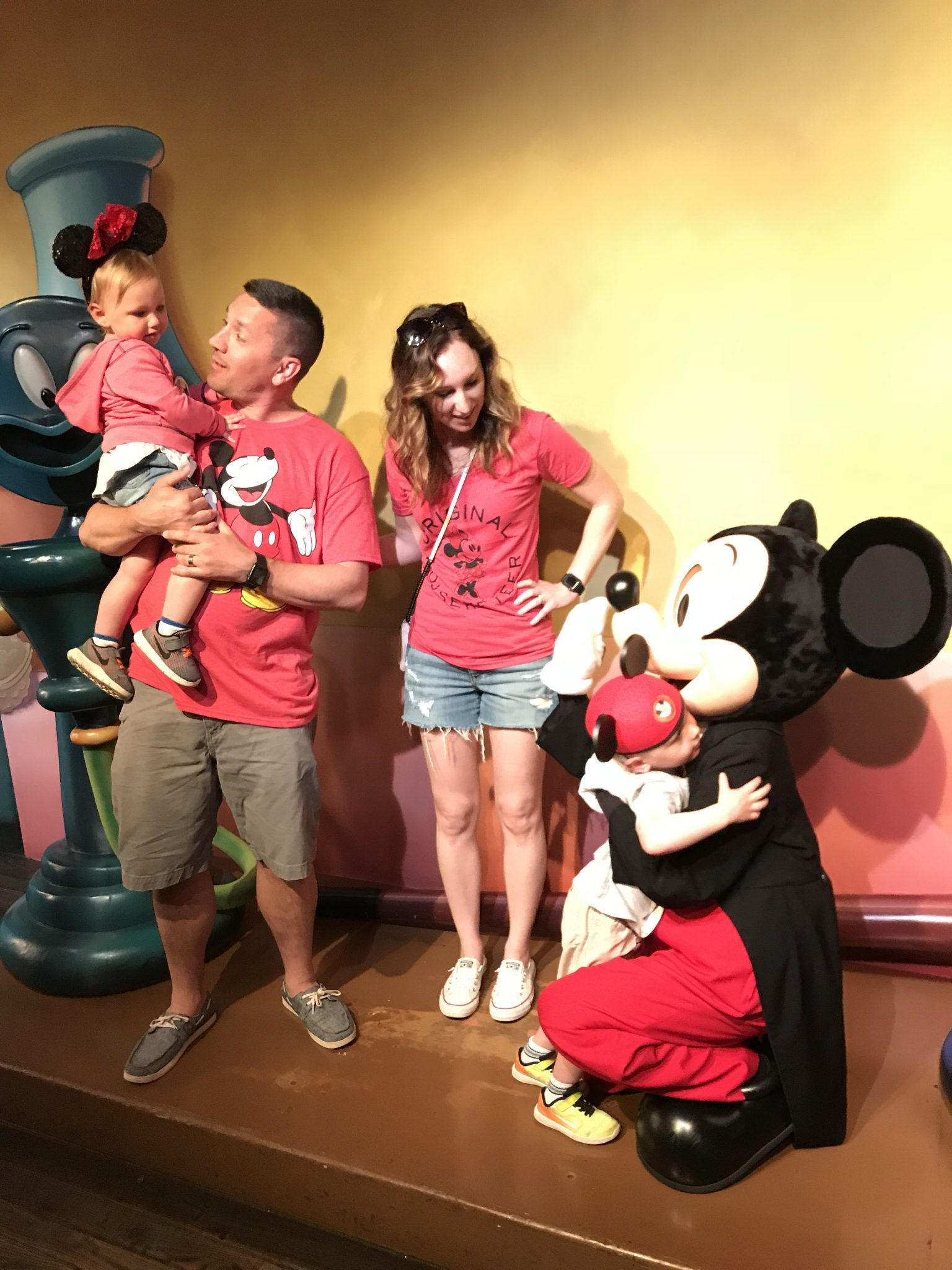 The kids meeting Mickey on our first trip to Disneyland