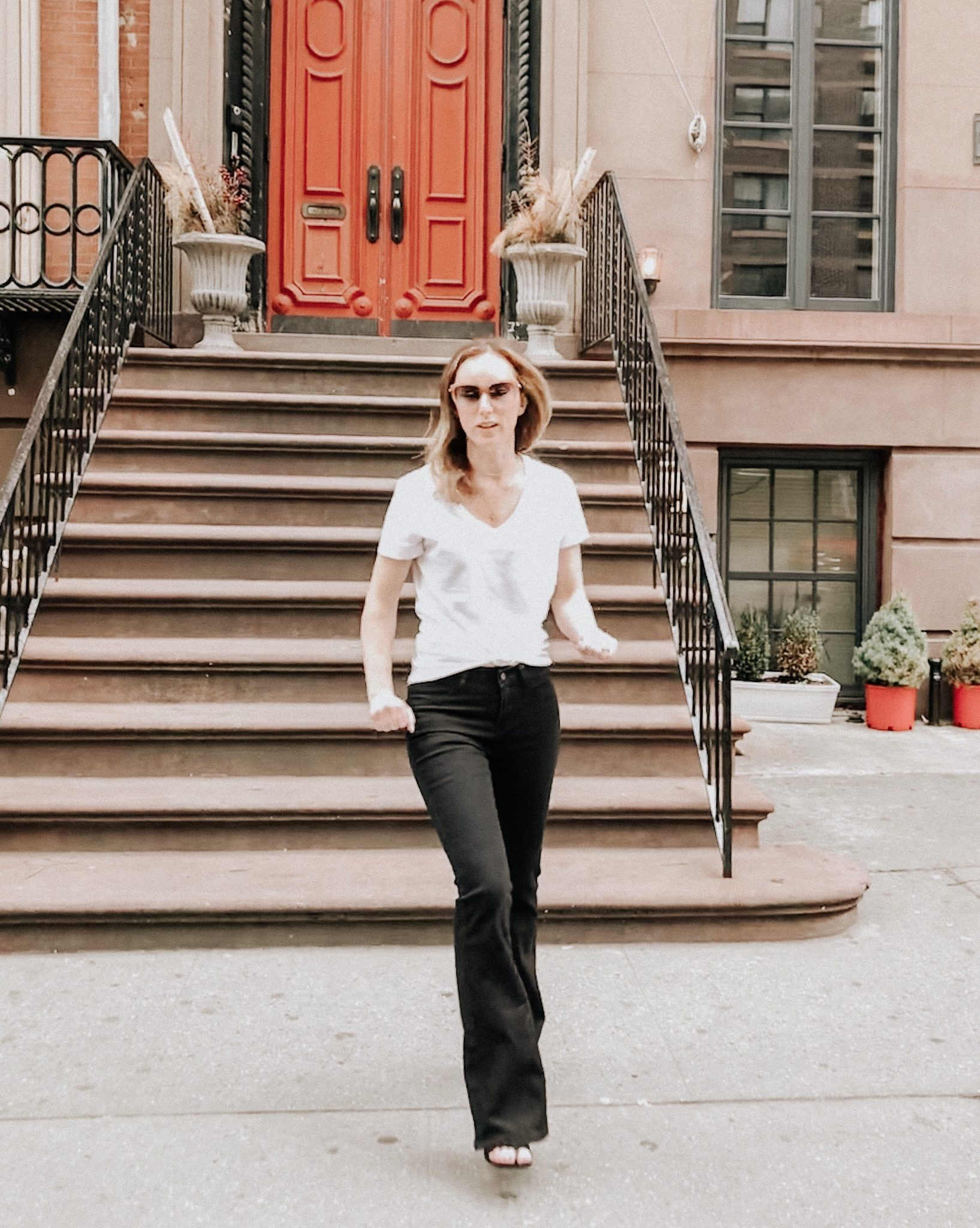 City fun in flares | Daily Splendor Life and Style Blog || Flare jeans, faux leather jacket, wide brim hat #flarejeans #blackjeans #citystyle #NYCfashion #bloggerstyle #casualchic