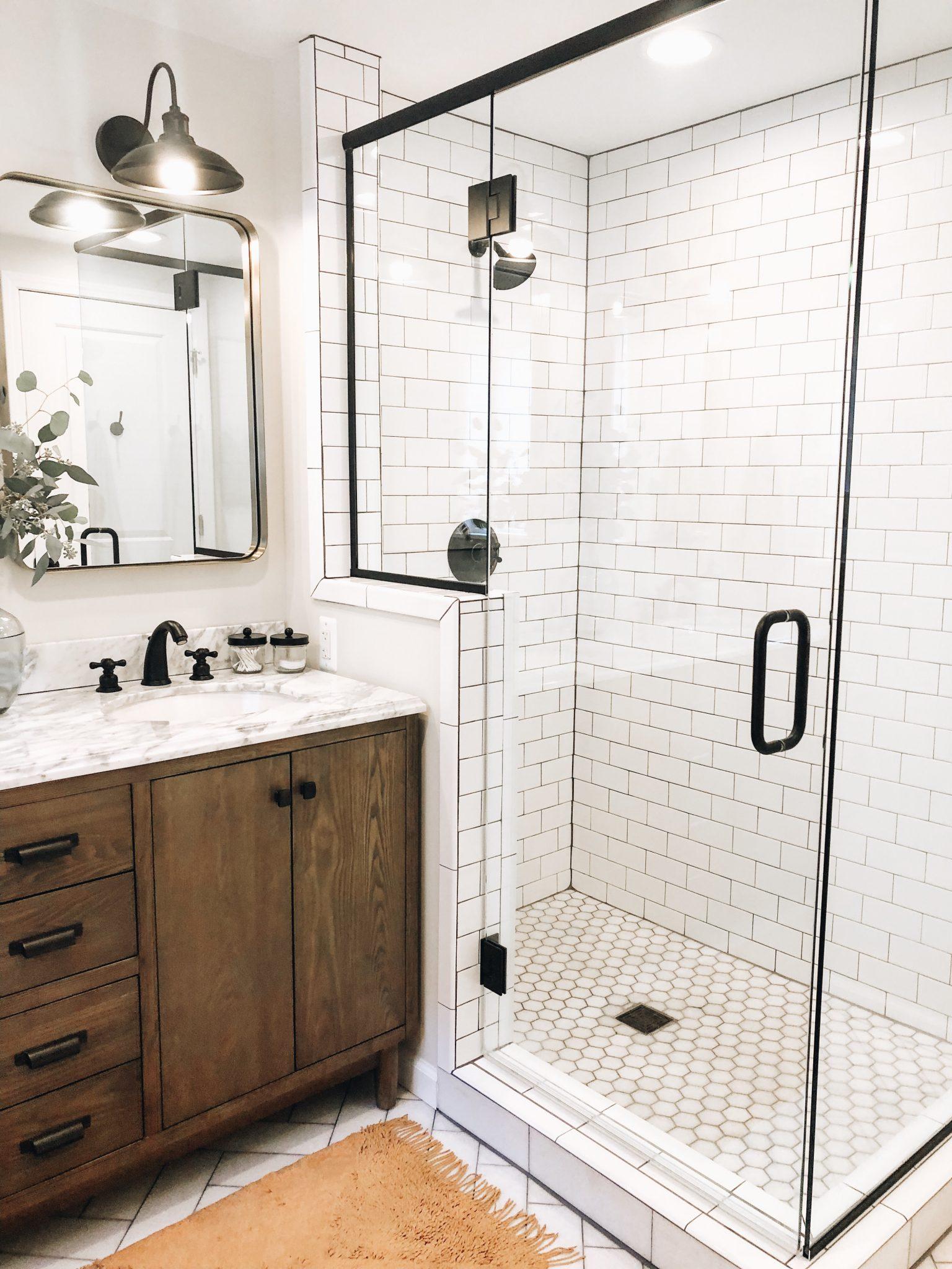 Master Bathroom Reveal | Daily Splendor Life and Style Blog | master bathroom #modernfarmhouse #modernfarmhousebathroom #Fixerupperstyle #contemporarybathroom #marbletile #subwaytile #subwaytileshower #herringbonetilefloor #matteblackbathroomfixtures