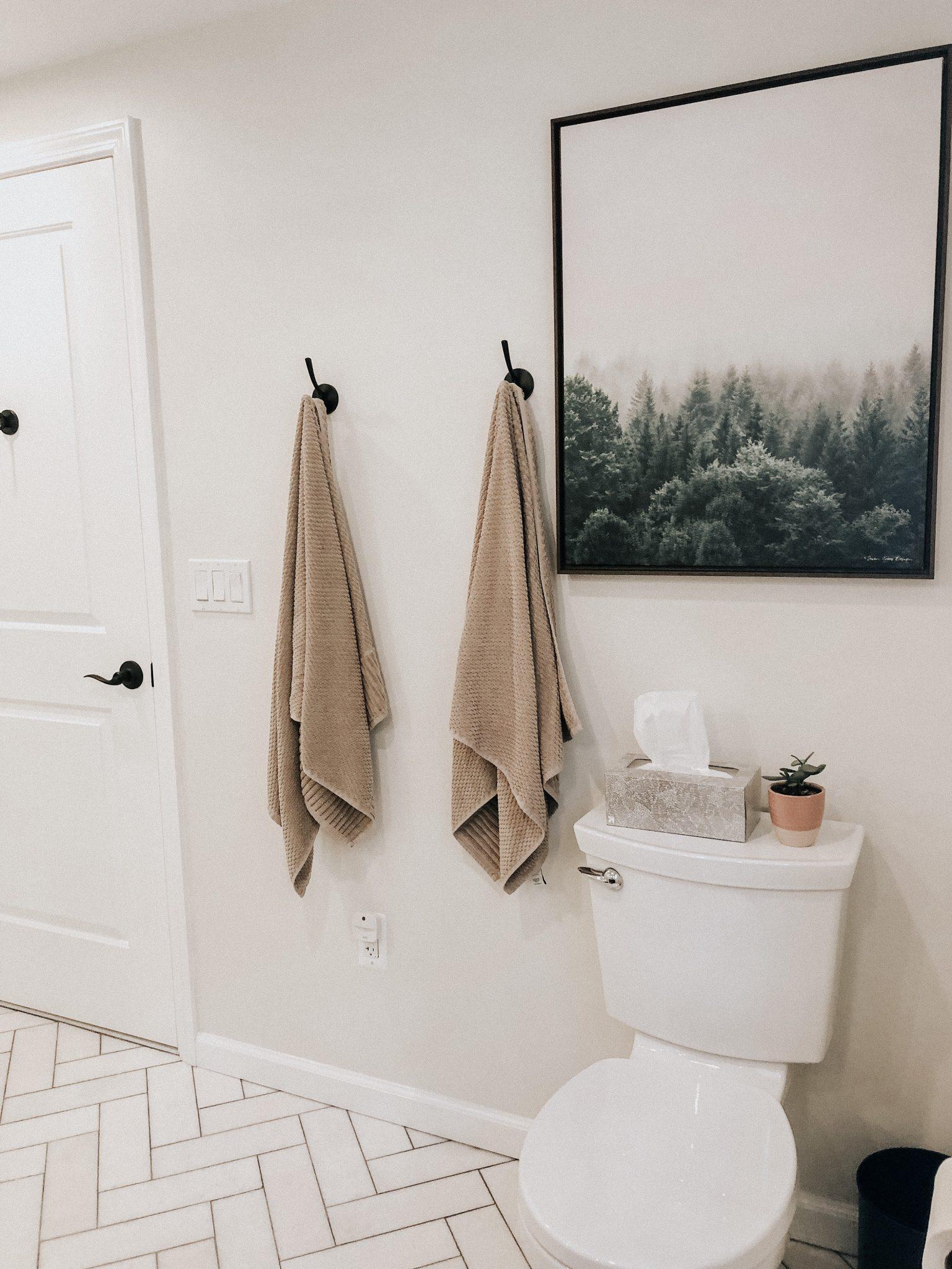 Master Bathroom Reveal | Daily Splendor Life and Style Blog | master bathroom #modernfarmhouse #modernfarmhousebathroom #Fixerupperstyle #contemporarybathroom #marbletile #subwaytile #behrpaint #behroffwhite #herringbonetilefloor #matteblackhooks