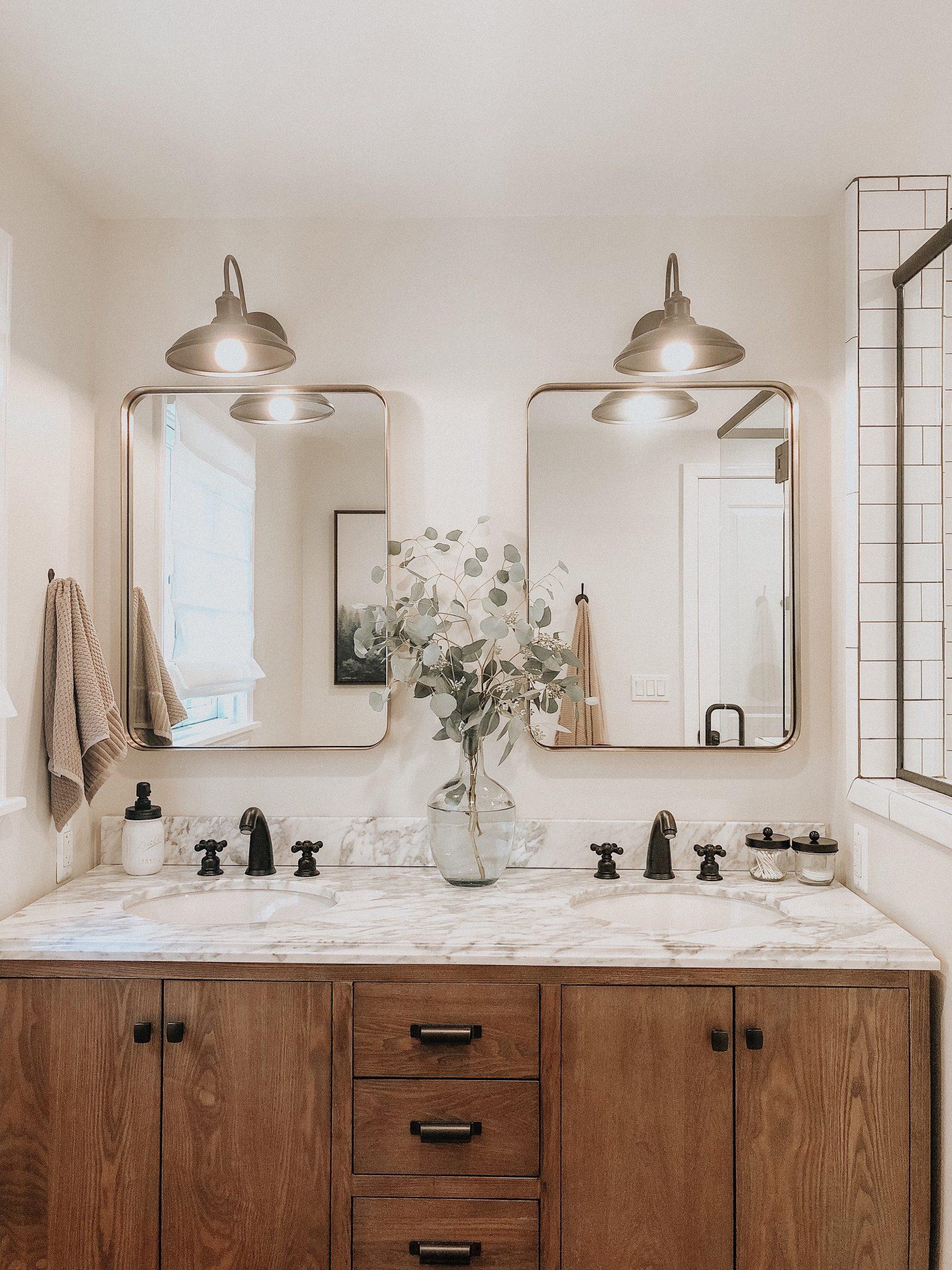 Master Bathroom Reveal | Daily Splendor Life and Style Blog | master bathroom #modernfarmhouse #modernfarmhousebathroom #Fixerupperstyle #contemporarybathroom #marbletile #subwaytile #subwaytileshower #herringbonetilefloor #matteblackbathroomfixtures #bathroomvanity #woodvanity