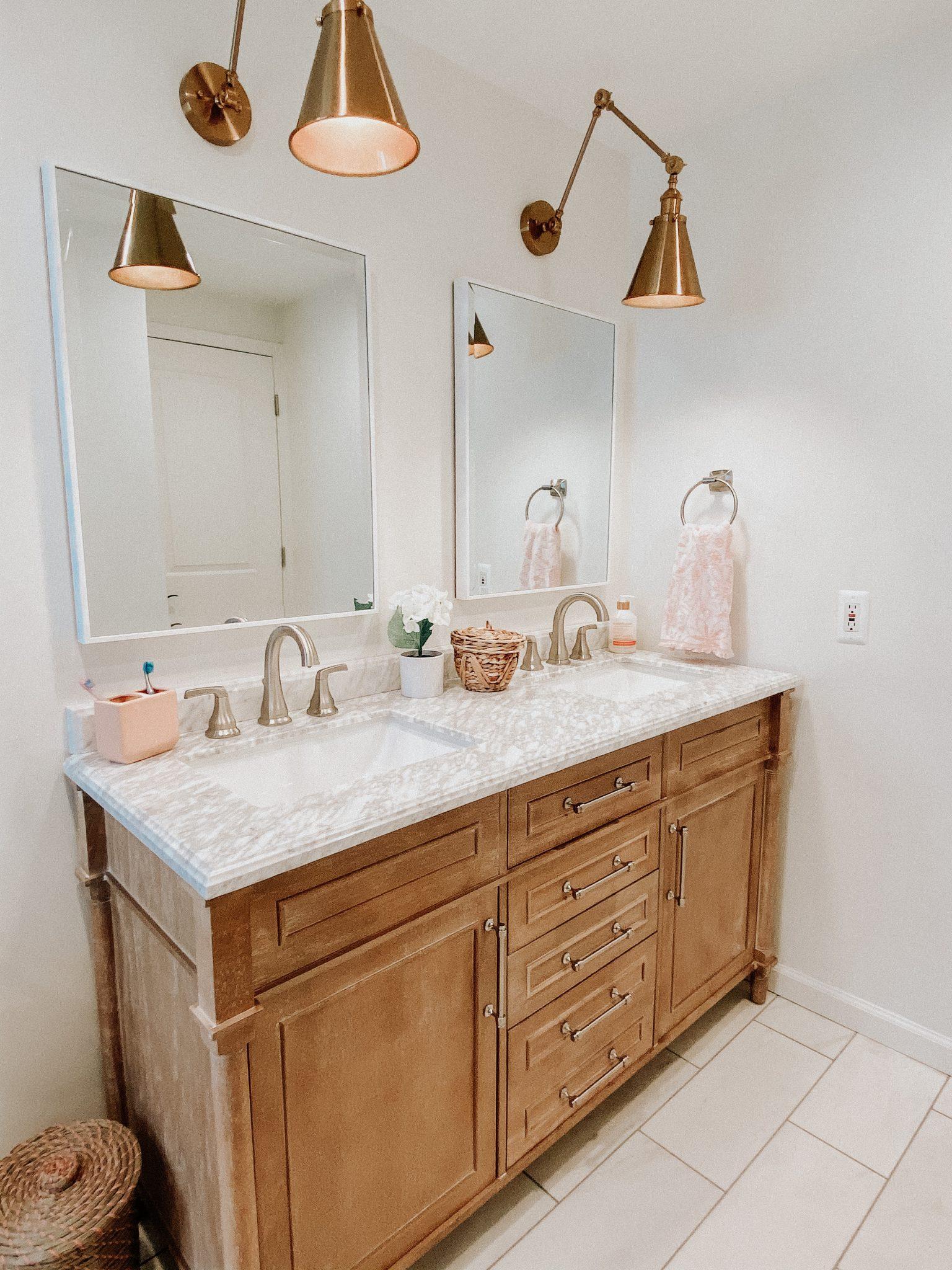 April favorites | Daily Splendor Life and Style Blog | Bathroom Vanity #goldsconce #woodvanity #coastalbathroom